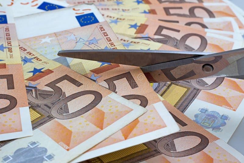 Scheren schnitten Euro stockbild
