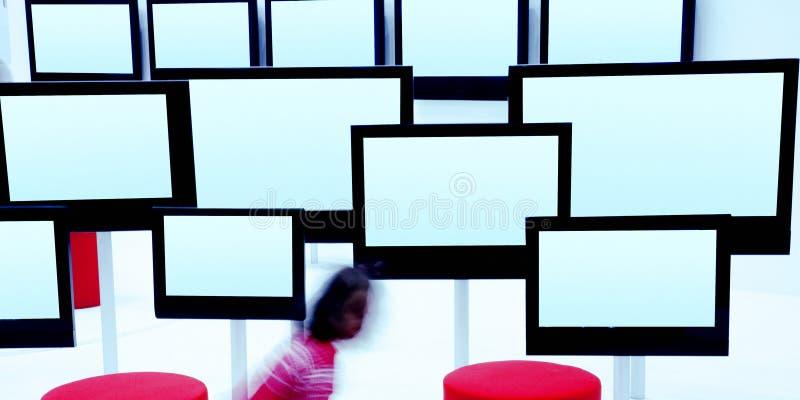 Schermi moderni della TV fotografie stock