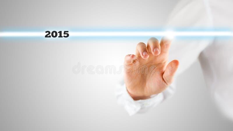 Schermo commovente della mano con evidenziato 2015 fotografia stock libera da diritti