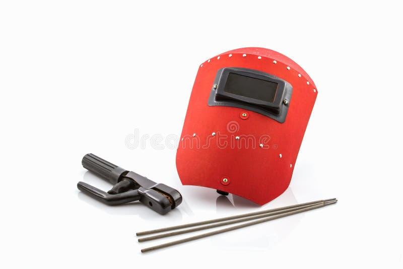 Schermo protettivo e barretta-supporto rossi con il wir degli elettrodi per saldatura immagini stock