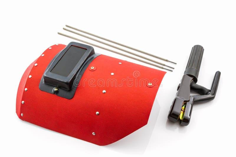 Schermo protettivo e barretta-supporto rossi con il wir degli elettrodi per saldatura fotografie stock libere da diritti