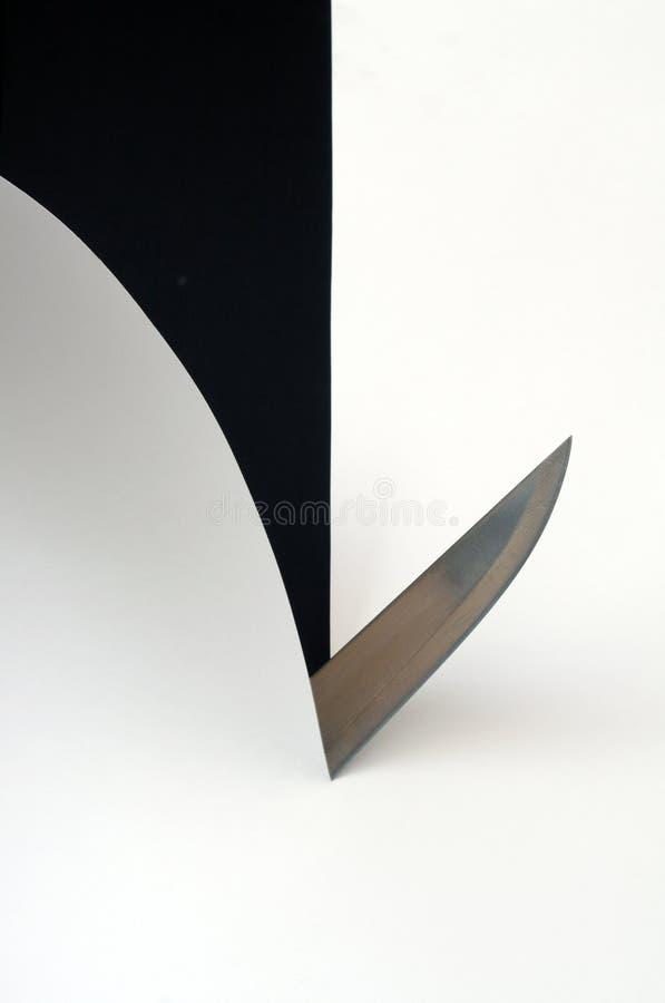 Scherp het document van het mes blad stock foto
