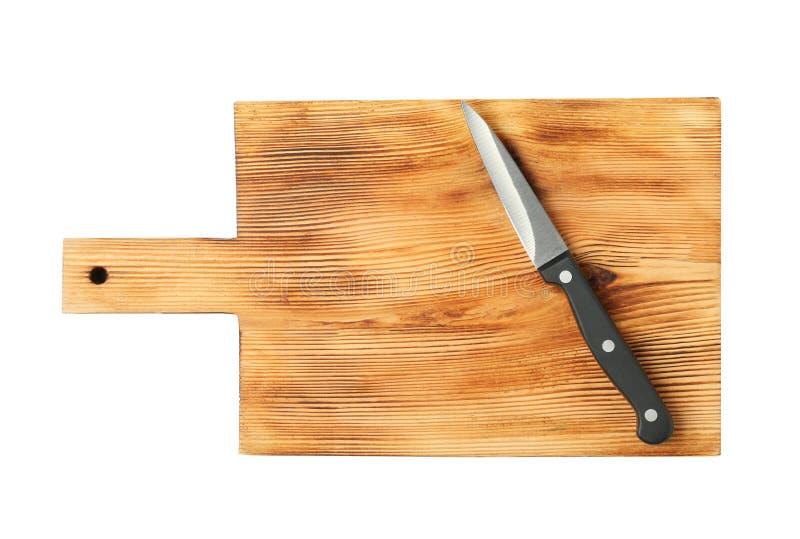 Scherp het knippen mes met houten die raad op wit wordt geïsoleerd royalty-vrije stock foto