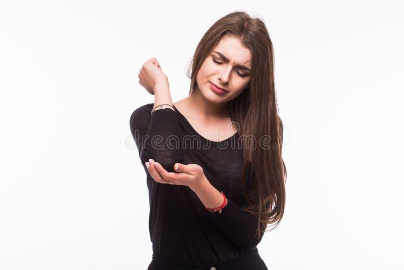Scherpe pijn in een vrouwenelleboog stock fotografie
