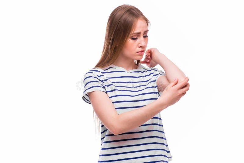 Scherpe pijn in een vrouwenelleboog stock afbeelding