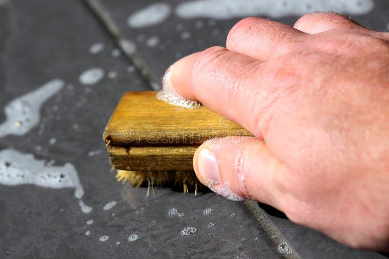Scheuernfußbodenfliesen stockbilder