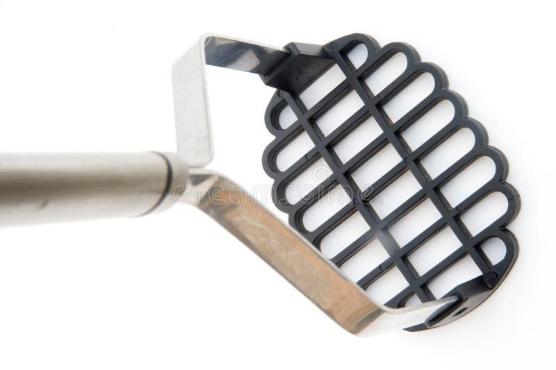 Schiacciatore della patata. fotografia stock