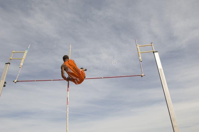 Schiarimento maschio Antivari del saltatore con l'asta immagine stock libera da diritti