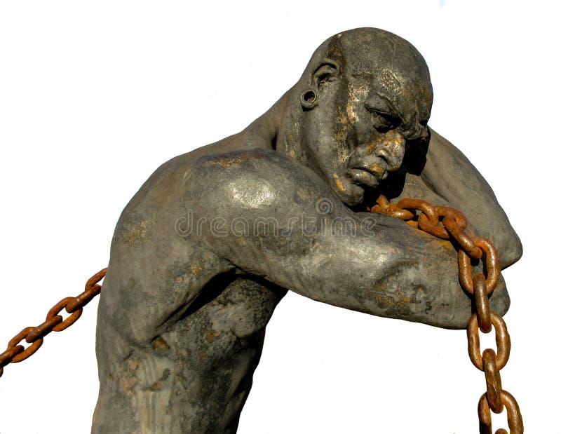 Schiavo Carrying una catena, isolata su fondo bianco immagine stock libera da diritti