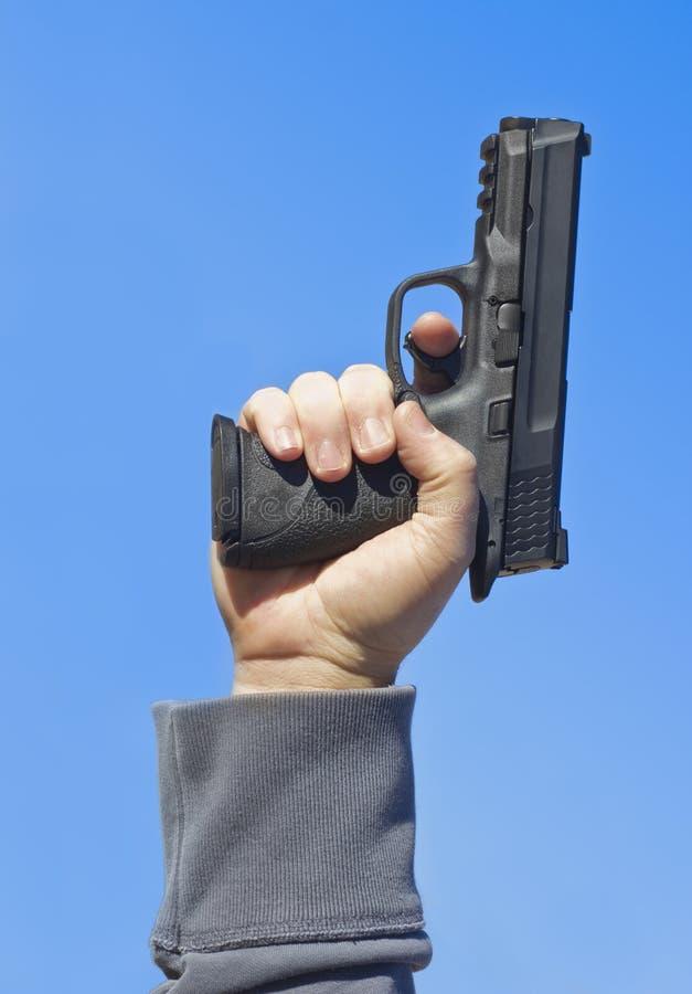 Schießen eines Handgewehrs stockfotografie