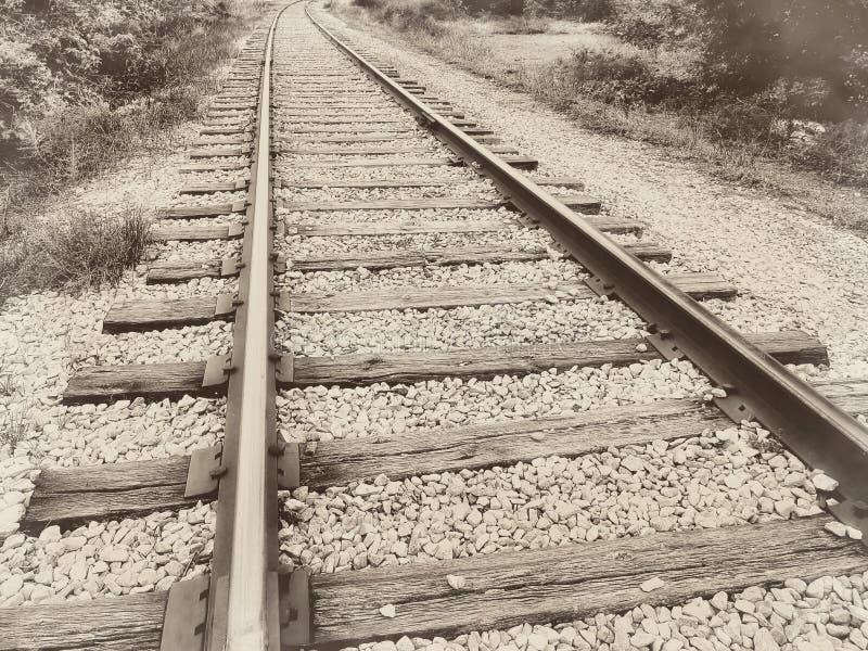 Schienenbahnstrecke-Weinlese der Speedwayeisenbahn alte Retro- Sepia stockfotografie