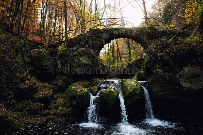Schiessentumpel Waterfall in Mullerthal region of Luxembourg. Schiessentumpel Waterfall in Luxembourg. Mullerthal trail in autumn. It is also known as Luxemburg` stock photo