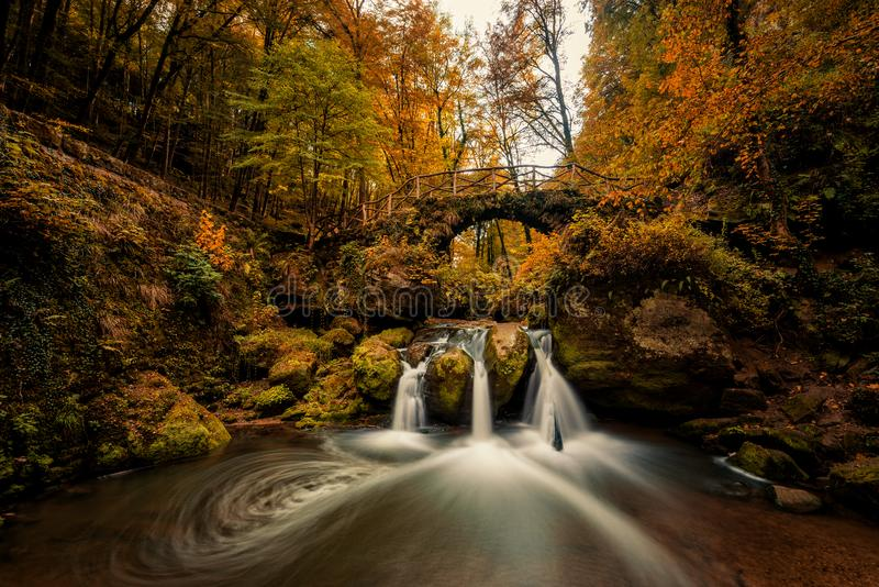 Schiessentumpel Waterfalls in Mullerthal. Autumn scenery at schiessentumpel waterfalls in Mullerthal stock images