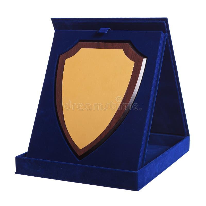 Schild gevormde trofee in een blauwe toekenningsdoos stock afbeeldingen
