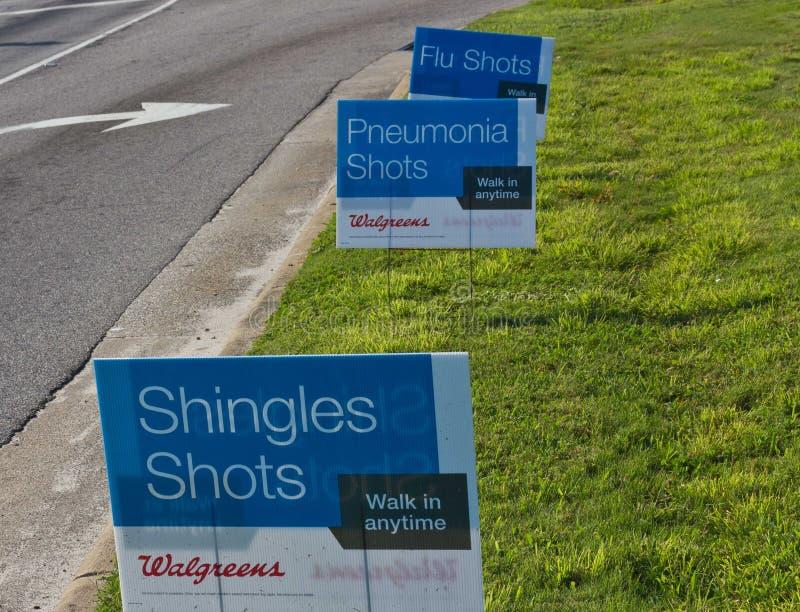 Schindeln, Pneumonie und Grippeimpfung-Zeichen stockfotografie