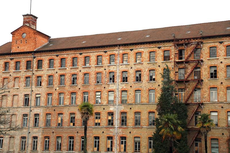 Schio, VI, Italy - March 6, 2016: Ancient factory of the firm ca. Schio, VI, Italy - March 6, 2016: facade of old factory of the firm called Lanerossi royalty free stock photos