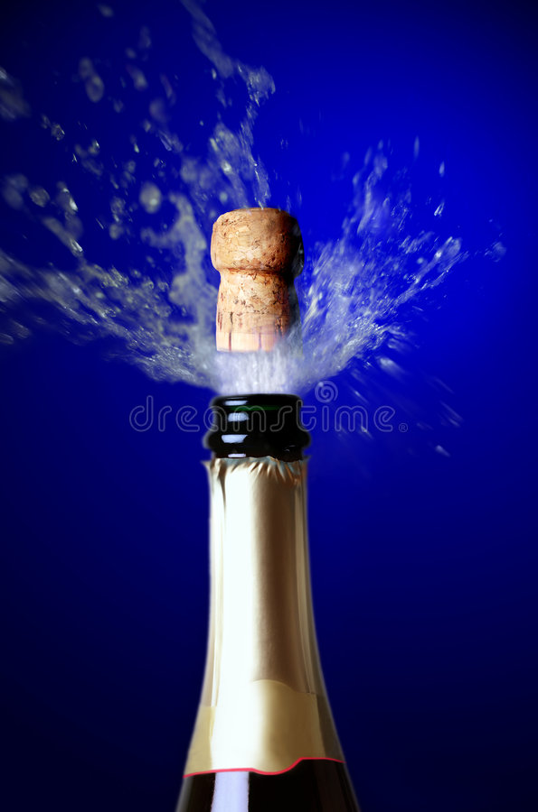 Schioccare del sughero di Champagne fotografie stock libere da diritti