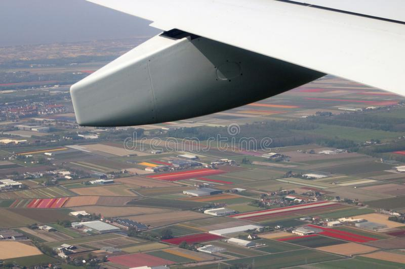 Dutch bulbfields from the air. View of Dutch bulb fields from the air taken from a plane about to land at Amsterdam Airport Schiphol in the Netherlands. Part of royalty free stock photos