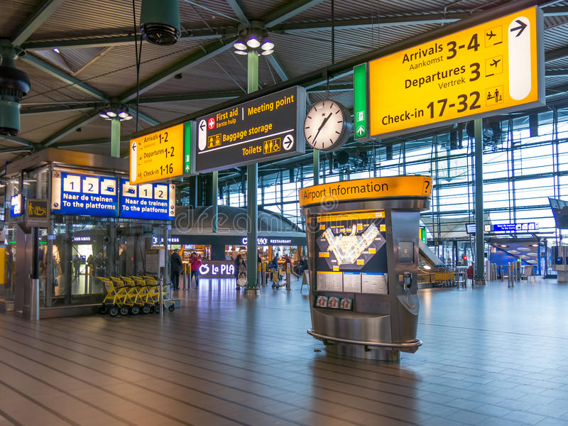 Schiphol Amsterdam Airport train terminal, Holland. Signs in train station of Schiphol Amsterdam Airport, Netherlands royalty free stock images