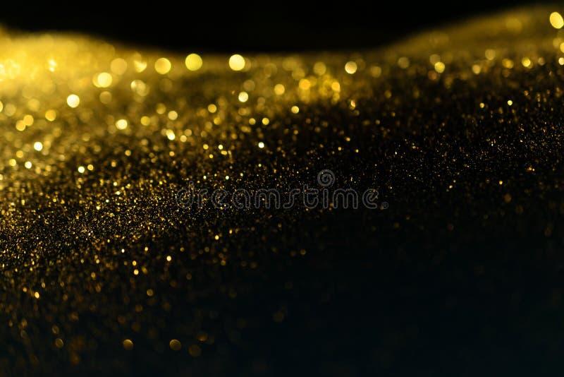 Schitter lichten grunge achtergrond, schittert het goud defocused abstracte Twinkly-Lichtenachtergrond royalty-vrije stock fotografie