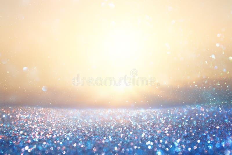 Schitter uitstekende lichtenachtergrond Blauw en goud Geconcentreerd DE royalty-vrije stock foto