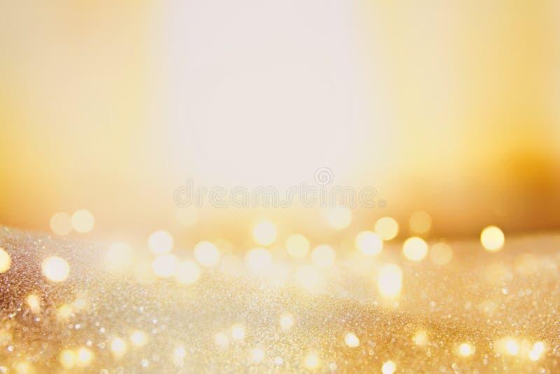 Schitter uitstekende lichtenachtergrond donkere goud en zwarte Geconcentreerd DE royalty-vrije stock foto's
