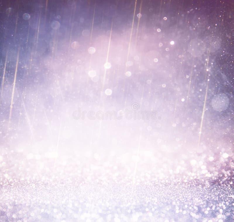 Schitter uitstekende lichtenachtergrond licht zilver, goud, purple en zwarte defocused royalty-vrije stock foto