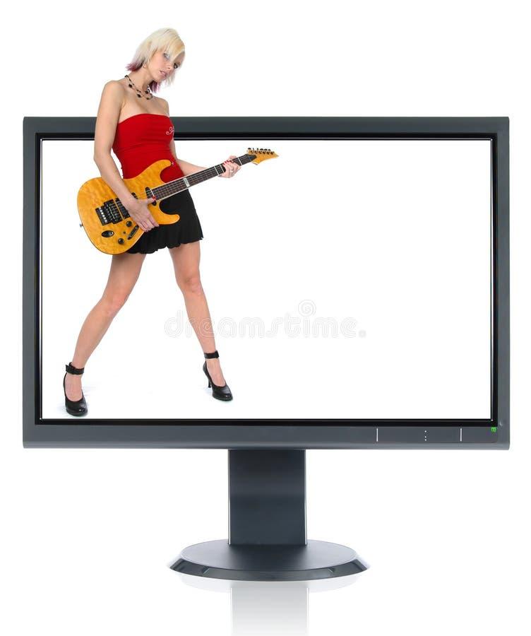 Schitterende gitaarspeler en monitor stock fotografie