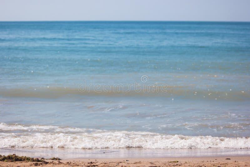 Schiuma sulla spiaggia fotografie stock
