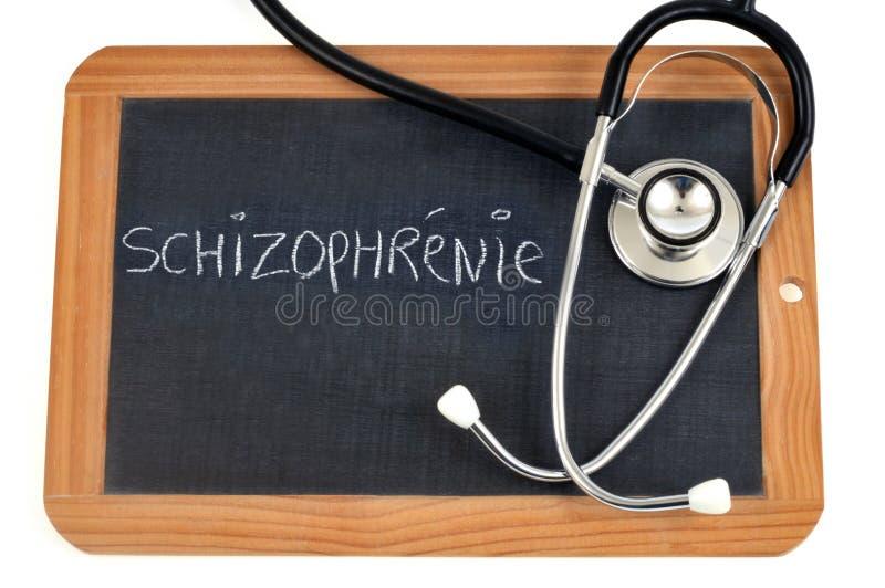 Schizofrenie in het Frans op een schoollei die wordt geschreven royalty-vrije stock foto
