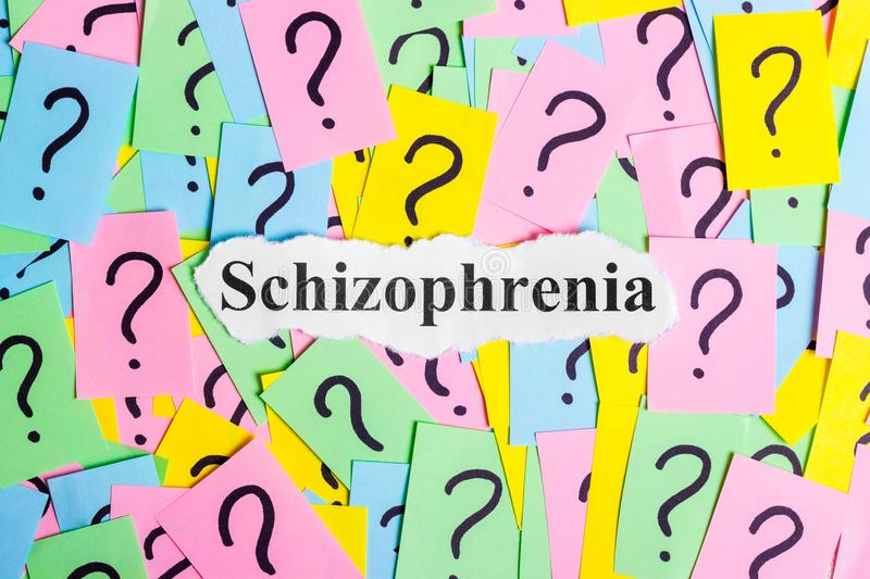 Schizophrenia Syndrome text on colorful sticky notes Against the background of question marks.  stock image