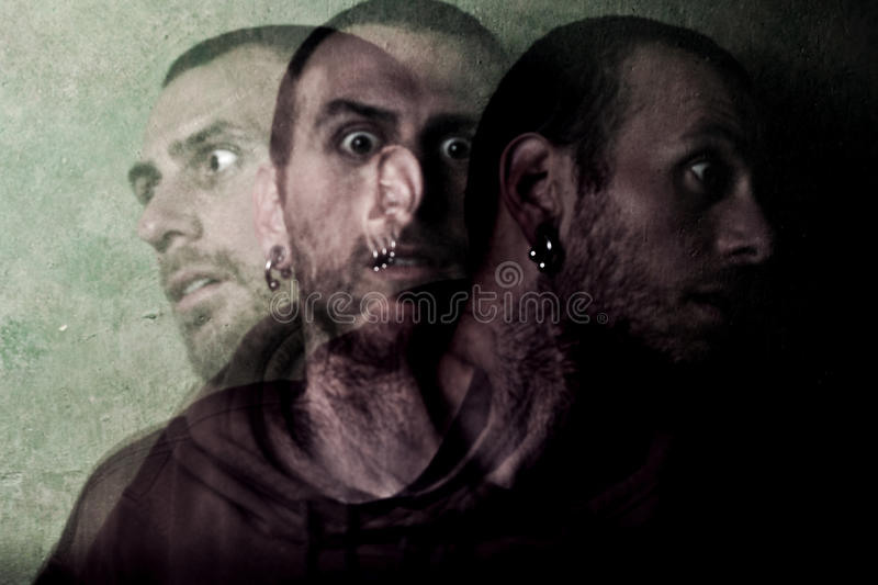 Schizophrenia. Young ill man with schizophrenia stock images