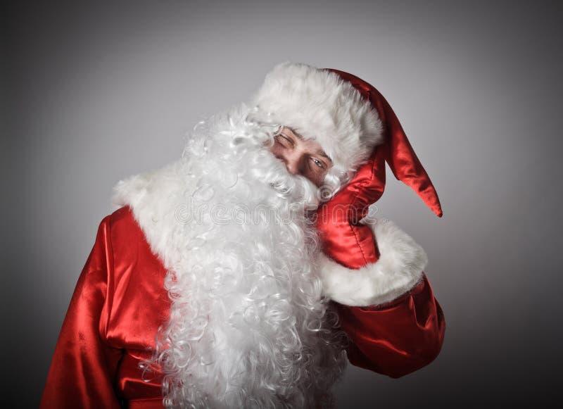 Schläfriger Weihnachtsmann stockfotos