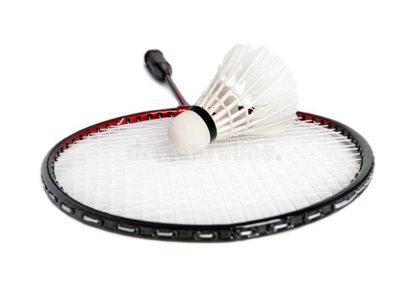 Schläger ist ein Badminton und ein Federball lizenzfreie stockfotografie
