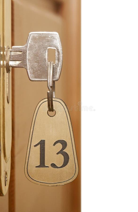 Schlüssel im Schlüsselloch lizenzfreie stockfotos