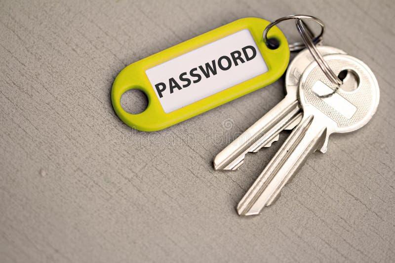 Schlüssel mit Aufkleberpasswort stockbild