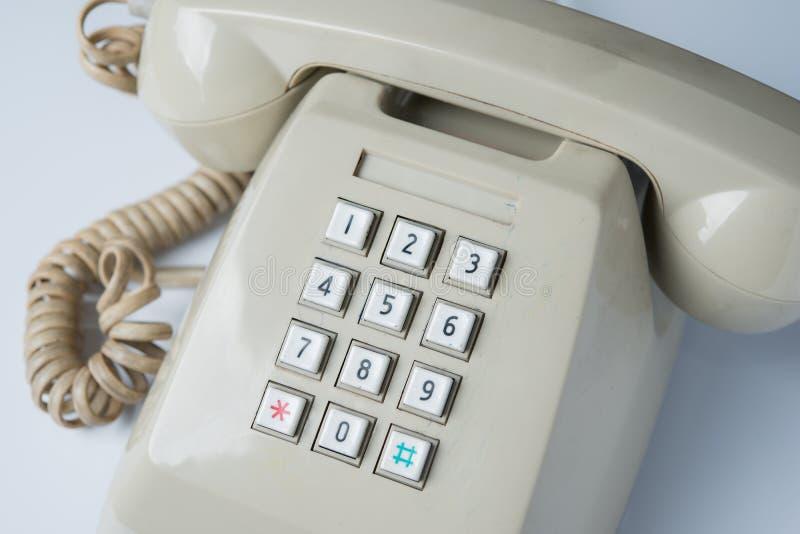 Schlüsselauflage des alten Telefons stockfoto