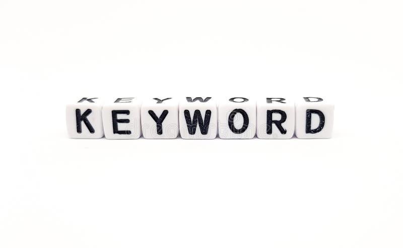Schlüsselwortwort aufgebaut mit weißen Würfeln und gotischen Schriften auf weißem Hintergrund stockbilder
