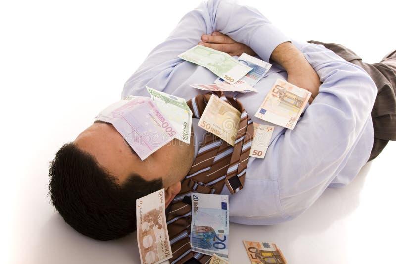 Schlafen mit dem Geld lizenzfreie stockbilder