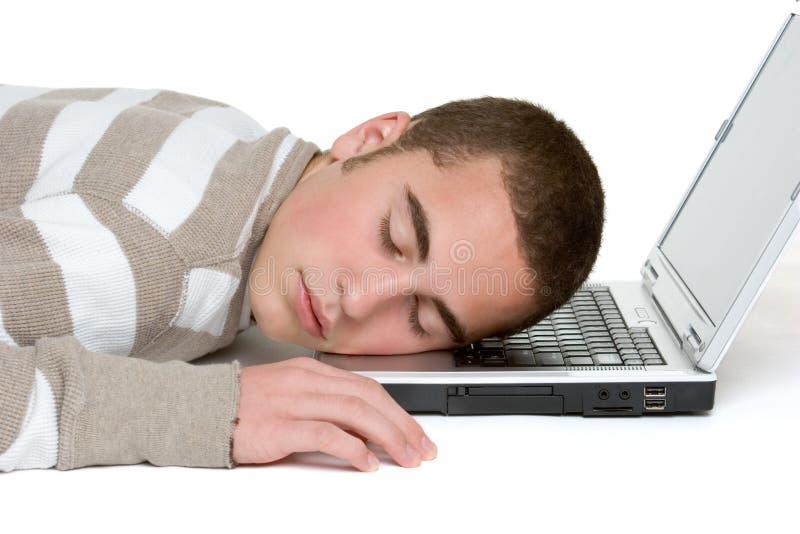 Schlafender Laptop-Junge lizenzfreie stockfotografie