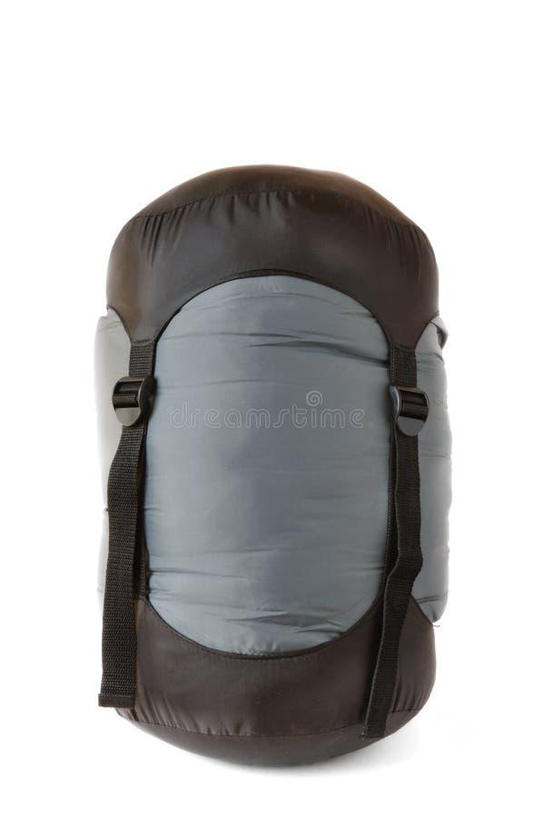 Schlafsack im schwarzen und grauen Komprimierung-Sack lizenzfreie stockfotos