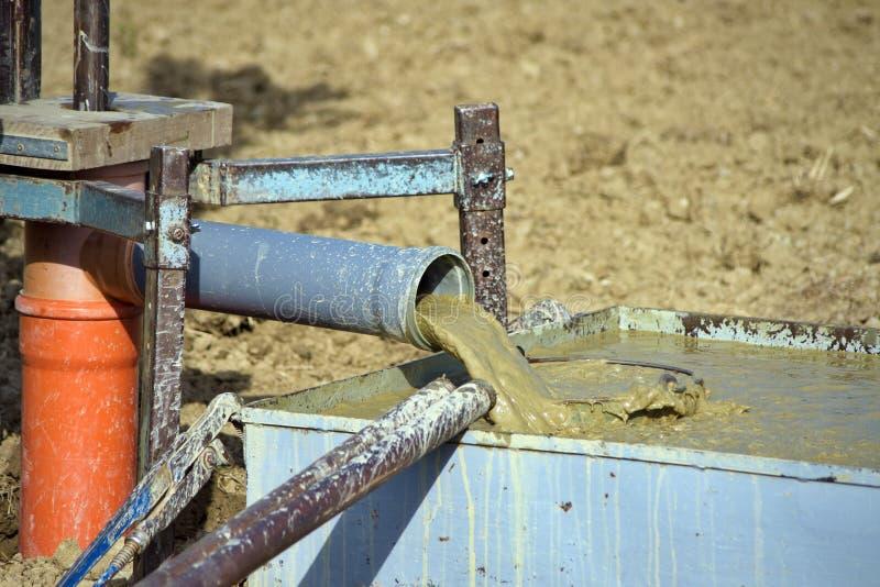 Schlammabfall von der Wasserbohrungsbohrung lizenzfreie stockfotografie