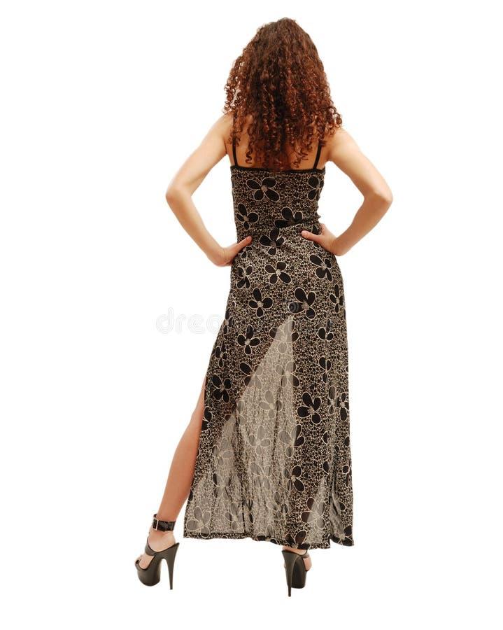 Schlanke Frau durch das transparente Kleid. lizenzfreies stockfoto