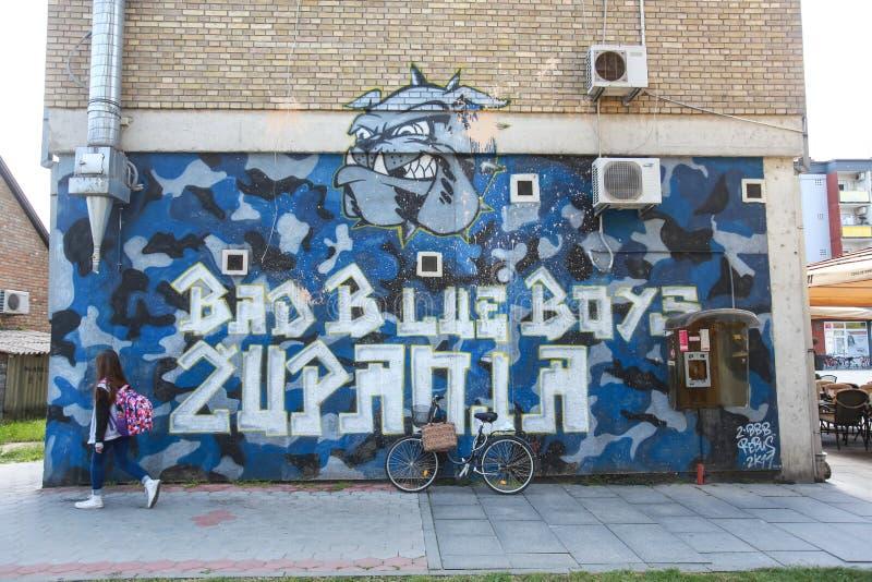 Schlechte Graffiti der blauen Jungen lizenzfreie stockfotografie