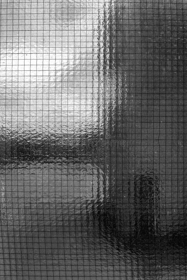 Schließen des Fensters mit Quadraten als Hintergrund lizenzfreie stockfotos