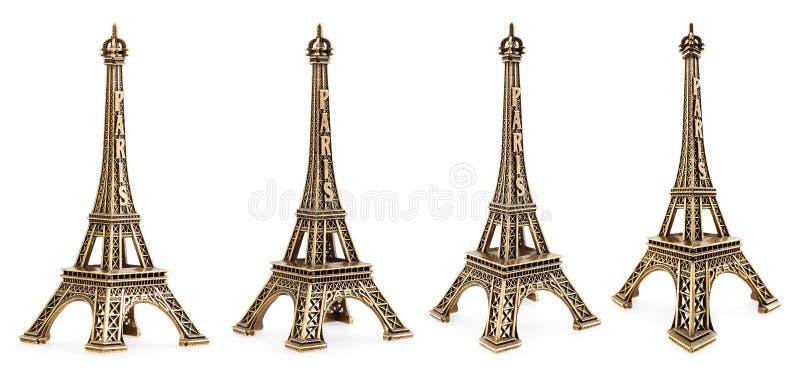 Schließen Sie herauf Ansicht einer kleinen Eiffelturmstatue, die mit verschiedenen Perspektiven fotografiert wird stockfotos