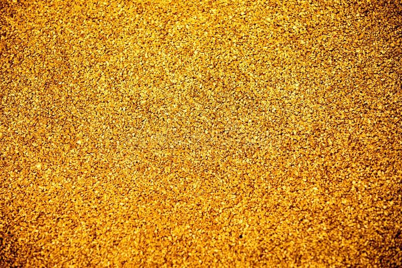 Schließen Sie herauf Beschaffenheit des gelbe Farbgummibodens auf Spielplatz stockbilder
