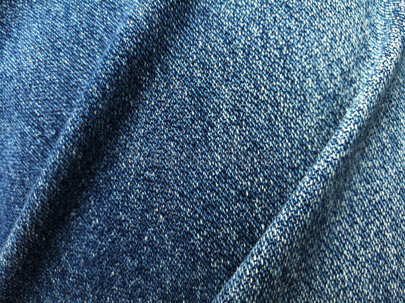 Schließen Sie herauf Blue Jeans-Denimfalte lizenzfreie stockfotos
