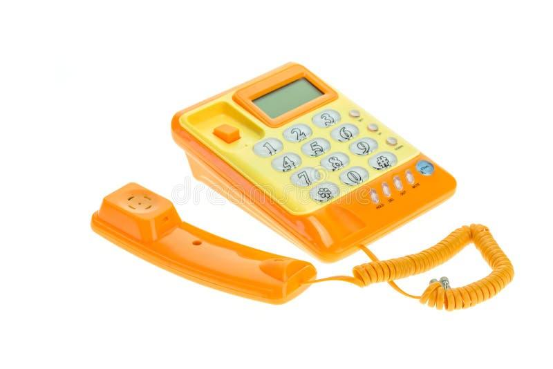 Schließen Sie herauf das orange Haupttelefon, das auf Weiß lokalisiert wird stockfotografie