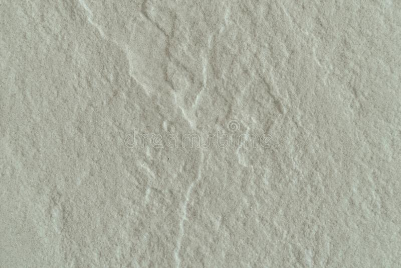 Schließen Sie herauf Oberfläche des rauen Steins, die gemaserte Wand lizenzfreies stockbild